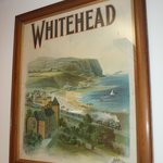 A century-old poster; Whitehead before the lighthouse was built.