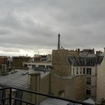 A top-floor view of the Eiffel Tower, from the room's balcony.