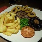 T bone steak and accompaniments