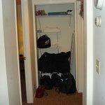 Closet in hallway to bedroom and bathroom