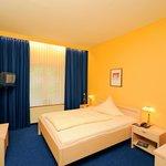 Einzelzimmer Komfort Plus mit Kingsize Bett
