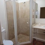 Poolside Room #15 - Glass enclosed shower stall.  (No bath tub)