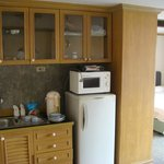 Kitchenette with bed in background