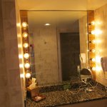 Two lit vanities with stools...