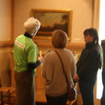 Visitors talking to docent