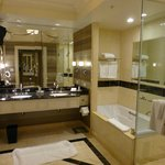 HUGE bathrooms, make-up table and separate toilet to the lef