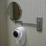 Wall-mounted hairdryer and magnifying make-up mirror