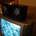 antiquated CRT TV and bizarre alarm/radio