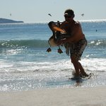My husband saving a pedlican. It's wings got twisted when it was pounded in the surf. It flew aw