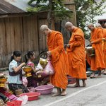 Alms giving.  Photo by Peter Derrett
