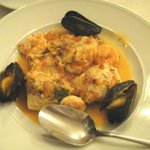 Fish in tomato broth with mussels