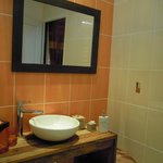 Clean and ample space in bathroom with separate toilet room