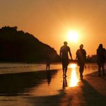 take a walk along the beach at sunset