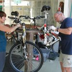 Putting our bikes together in the yard.