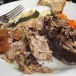 Delicious rolled pulled pork with black pudding