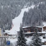 The hotel on the right side of the slope after snowfall