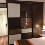 Wardrobe nicely hidden behind sliding panels