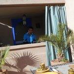 Maroune preparing breakfast on the terrasse