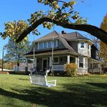 Manor House (1895), 3000 sq ft deck (added 2012, on left), and catalpa tree loveseat swing.