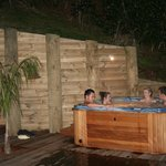 Enjoying the outdoor spa at night