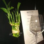 Simple bamboo plants adorn the tables