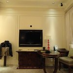 Large TV infront of a comfortable sofa - Deluxe Executive Room