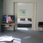 from lounge through to bedroom,TV on table with castors easy to move to where