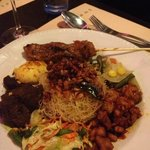 Fried rice noodles with beef rendang, chicken satay & vegetables