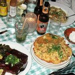 Ribs, mac'n cheese with side fried chicken on top, mojito