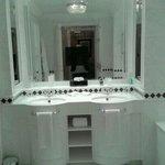 bathroom with tv in mirror