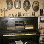 antique piano in palor