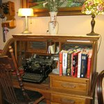 antique desk and typewriter in palor