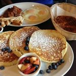 Wonderful brunch on Sundays.  Blueberry pancakes (background 2 eggs + potato breakfast).