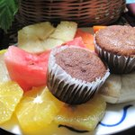 A welcoming plate of fruit and banana muffins