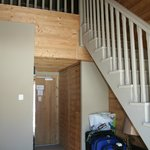 Stairs to children's floor with bunk beds