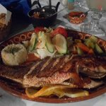 Los 3 Delfinis dinner only (  next door  ) - dining on grilled red snapper