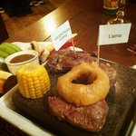 Argentinian Horse,Llama and beef steaks on a Hot Rock