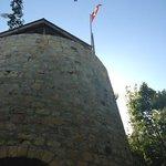 old sugar mill and Antiguan flag