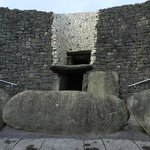 Chamber entrance with Neolithic stone carving.