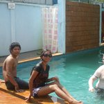 my son his wife an friend in the pool