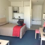 Kitchenette and bed in room
