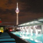 Roof top pool and tower at night