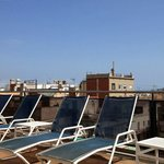 The deck chairs next to the pool on the roof.