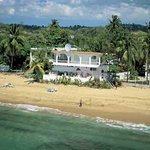 Small garden inn on a crystal clear water, beautiful sandy beach.