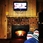 Relaxing in front of the fire and watching the game