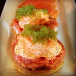 Inari Special: Tofu Pocket stuffed with spicy tuna, creamy scallops, and wasabi tobiko