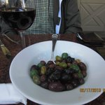 A Glass of Pinot and a plate of marinated olives