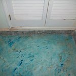 bathroom area in front of the sink, could have been cleaner