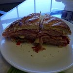 HALF of the SMALL Muffaletta sandwich.