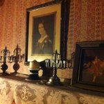 Hallway with Old portrait and candelabras